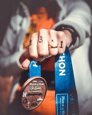 watches for runners with a heart rate monitor - marathon medal